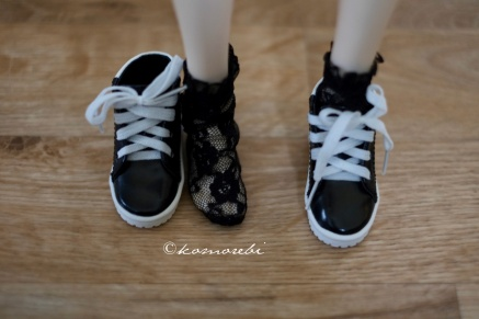 With MSD sneakers (note: these are sized for the actual Volks MSD, not other companies' 1:4 dolls). Volks MSD is the most common 1:4 shoe size, so these items are easy to find!